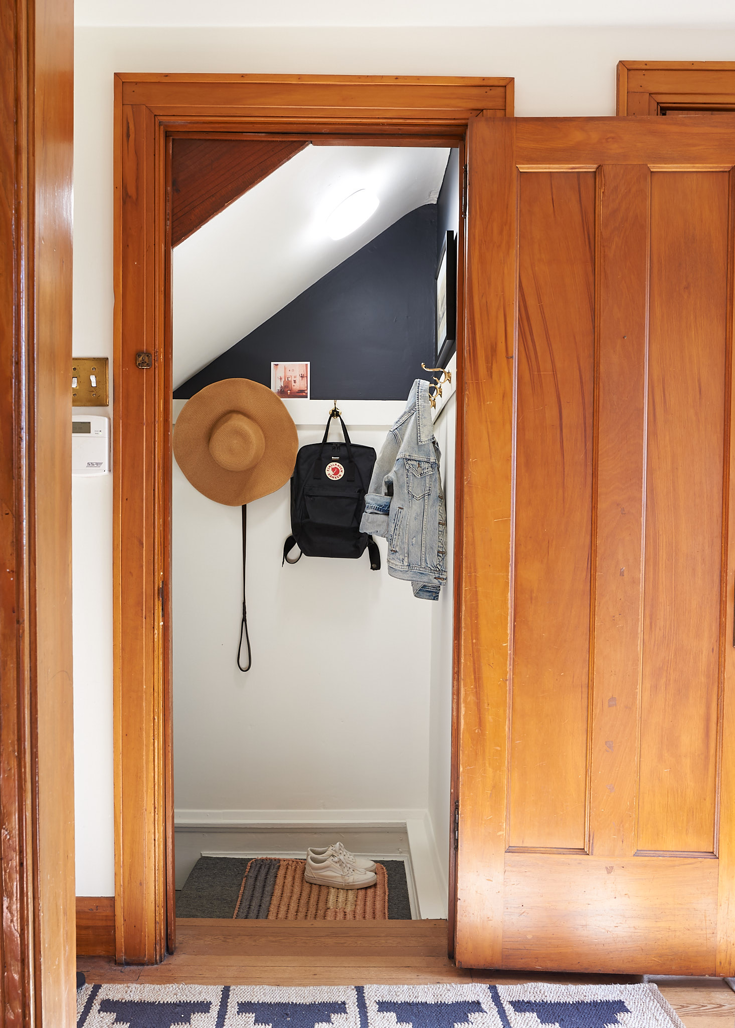 Sloped ceiling entryway with wall hooks