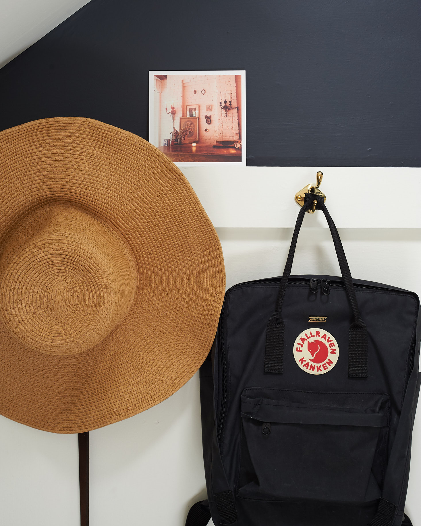 detail of sun hat and backpack