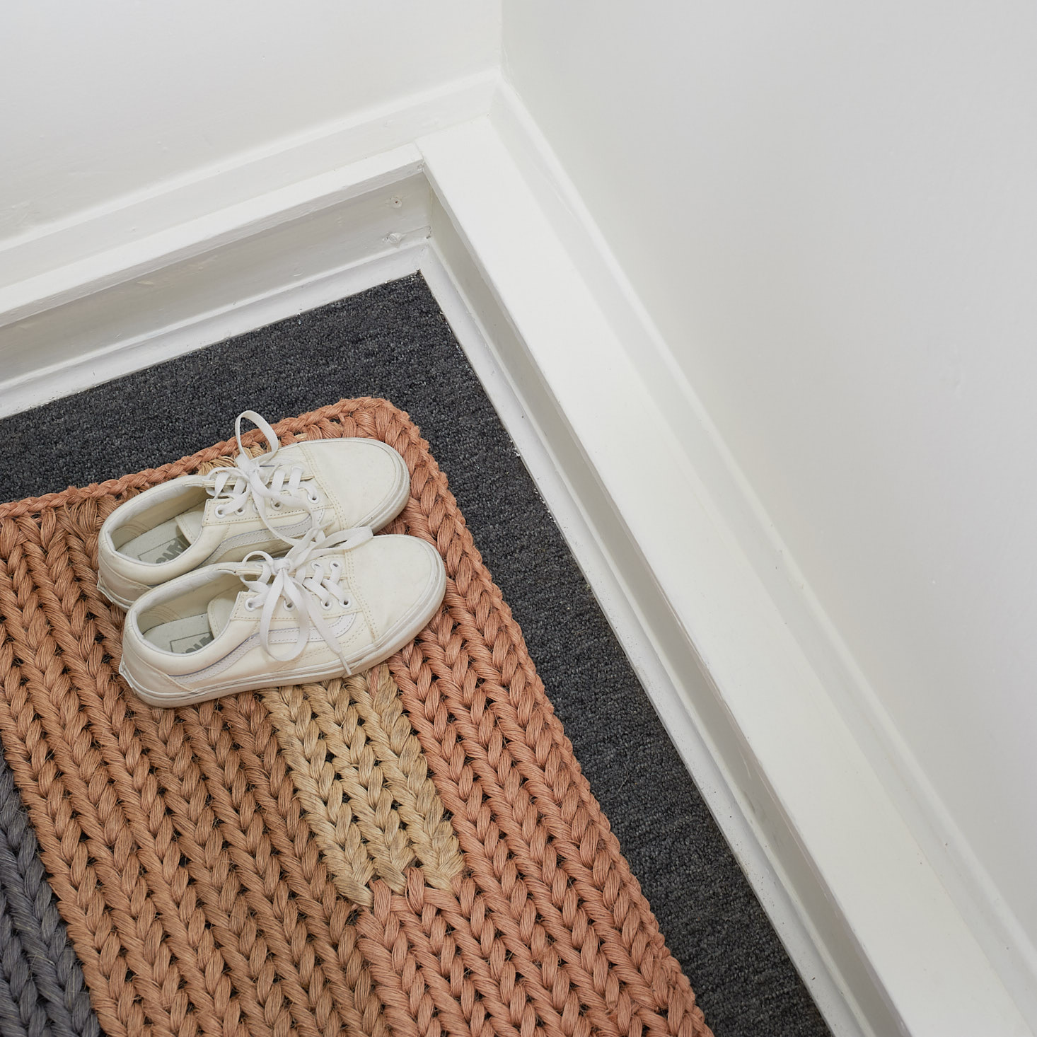 detail of white vans and someware floor mat