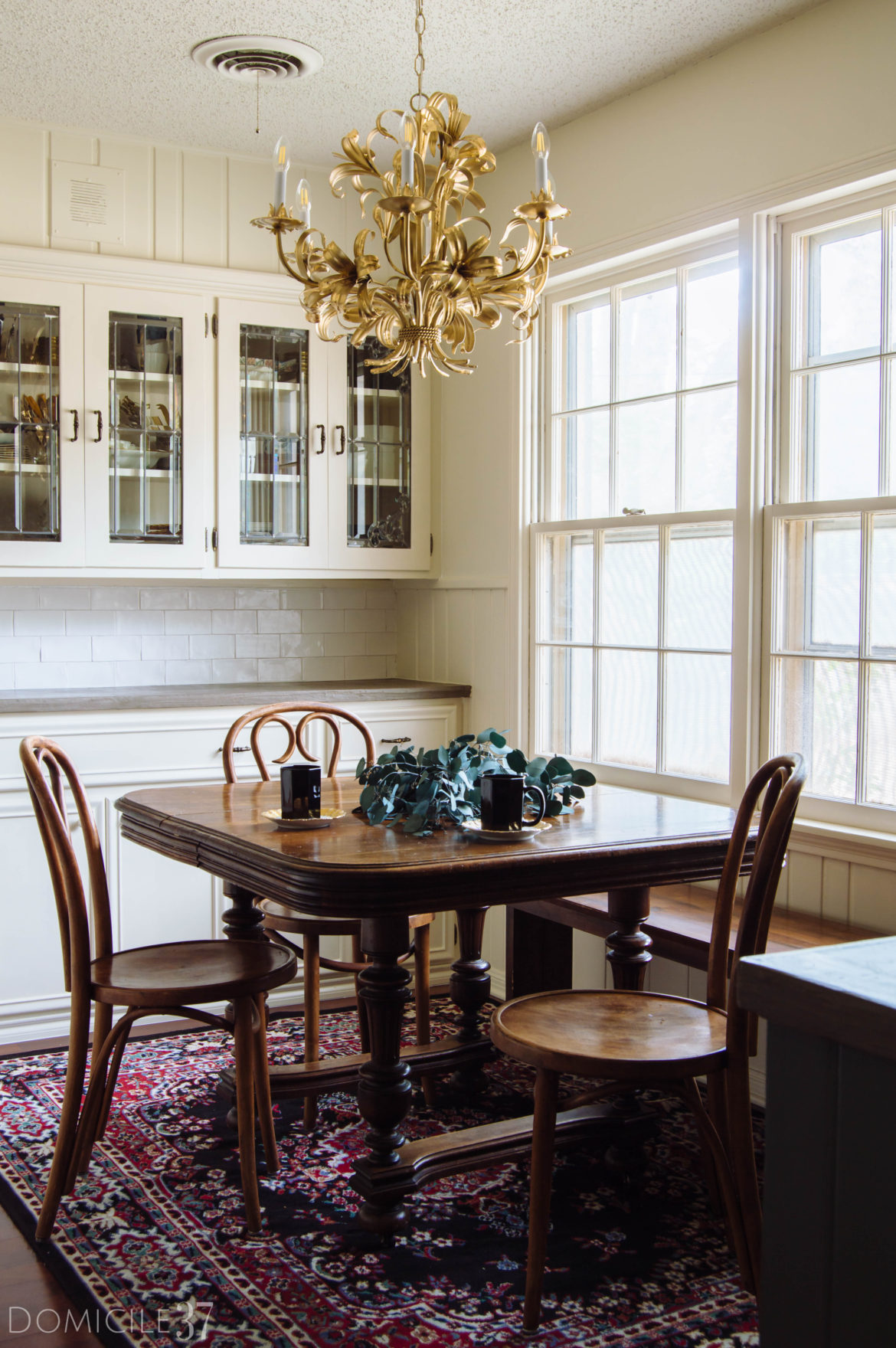 Traditional Breakfast Room with Glass Door Cabinets