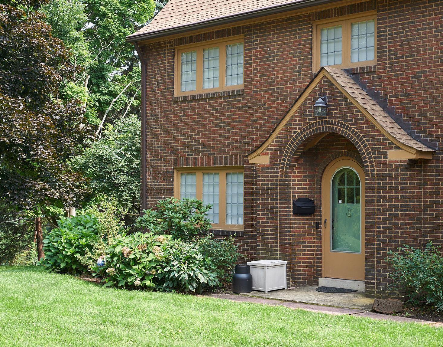 brick tudor exterior round door