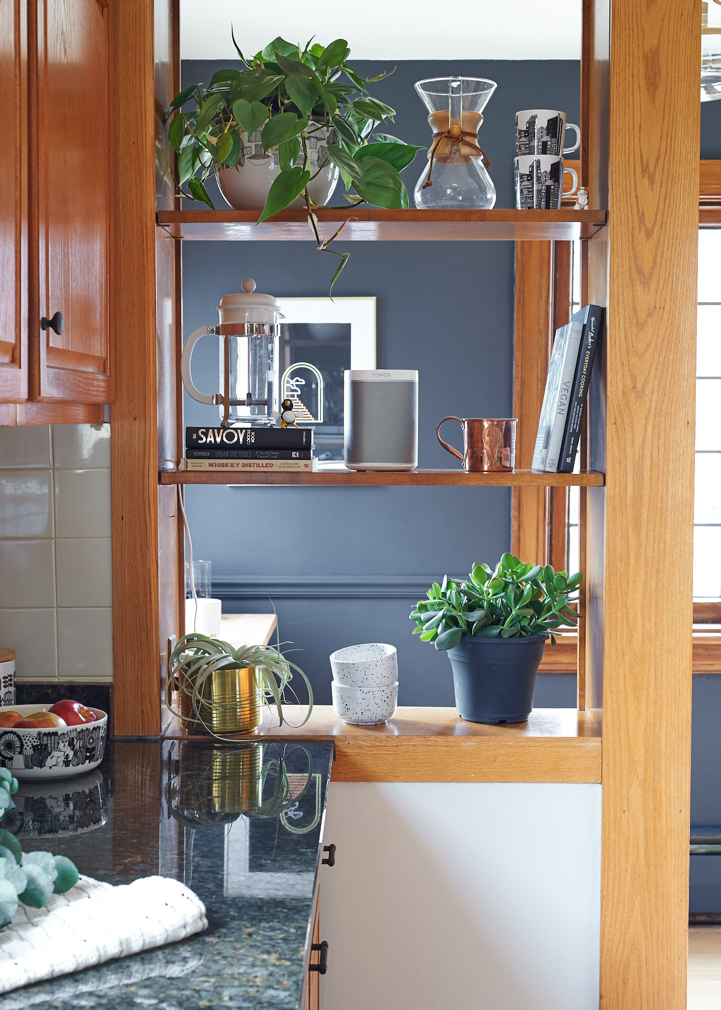 styled kitchen shelves plants wrought iron paint