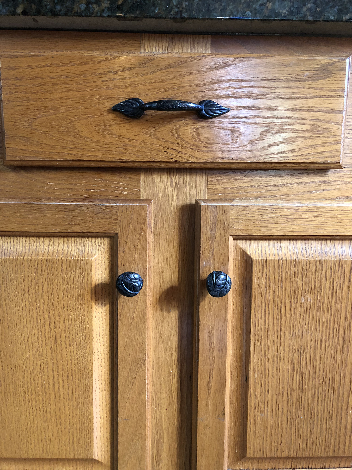 oak cabinets with leaf hardware