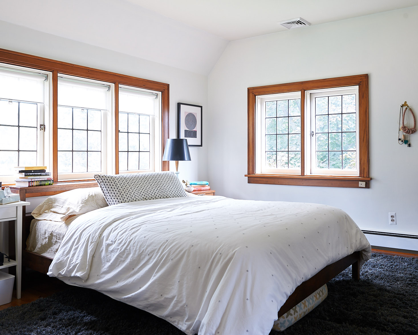 White wall master bedroom leaded glass windows