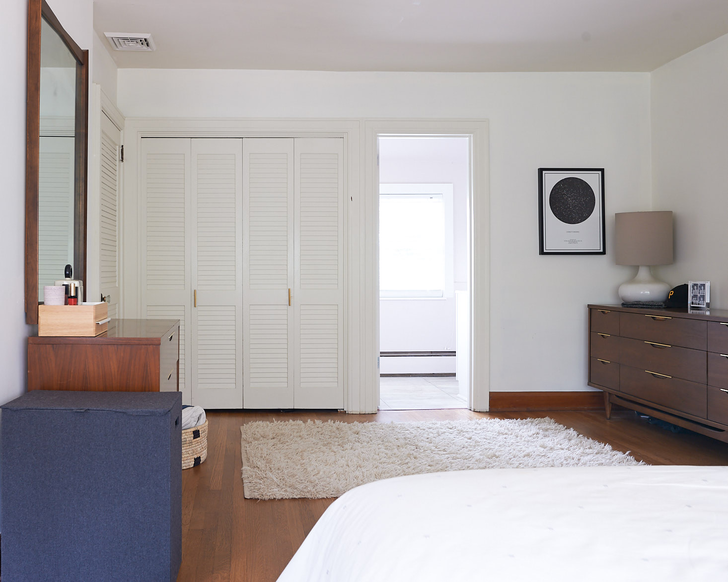 white master bedroom louvered closet