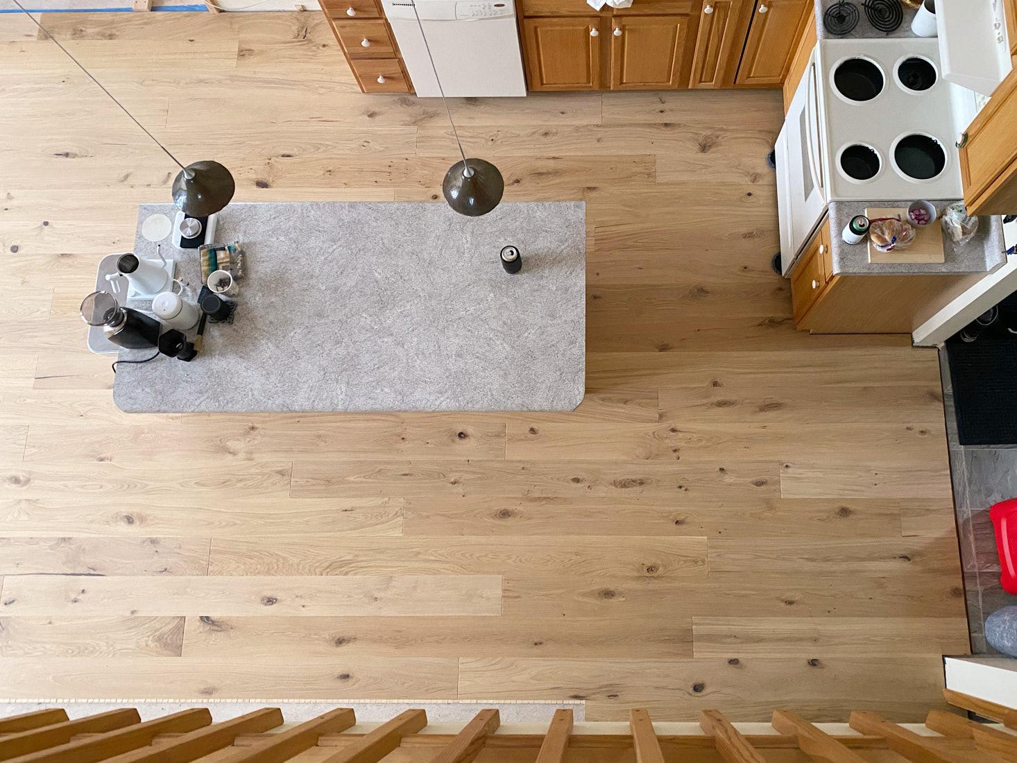Stuga Kahrs flooring installed around existing kitchen cabinets