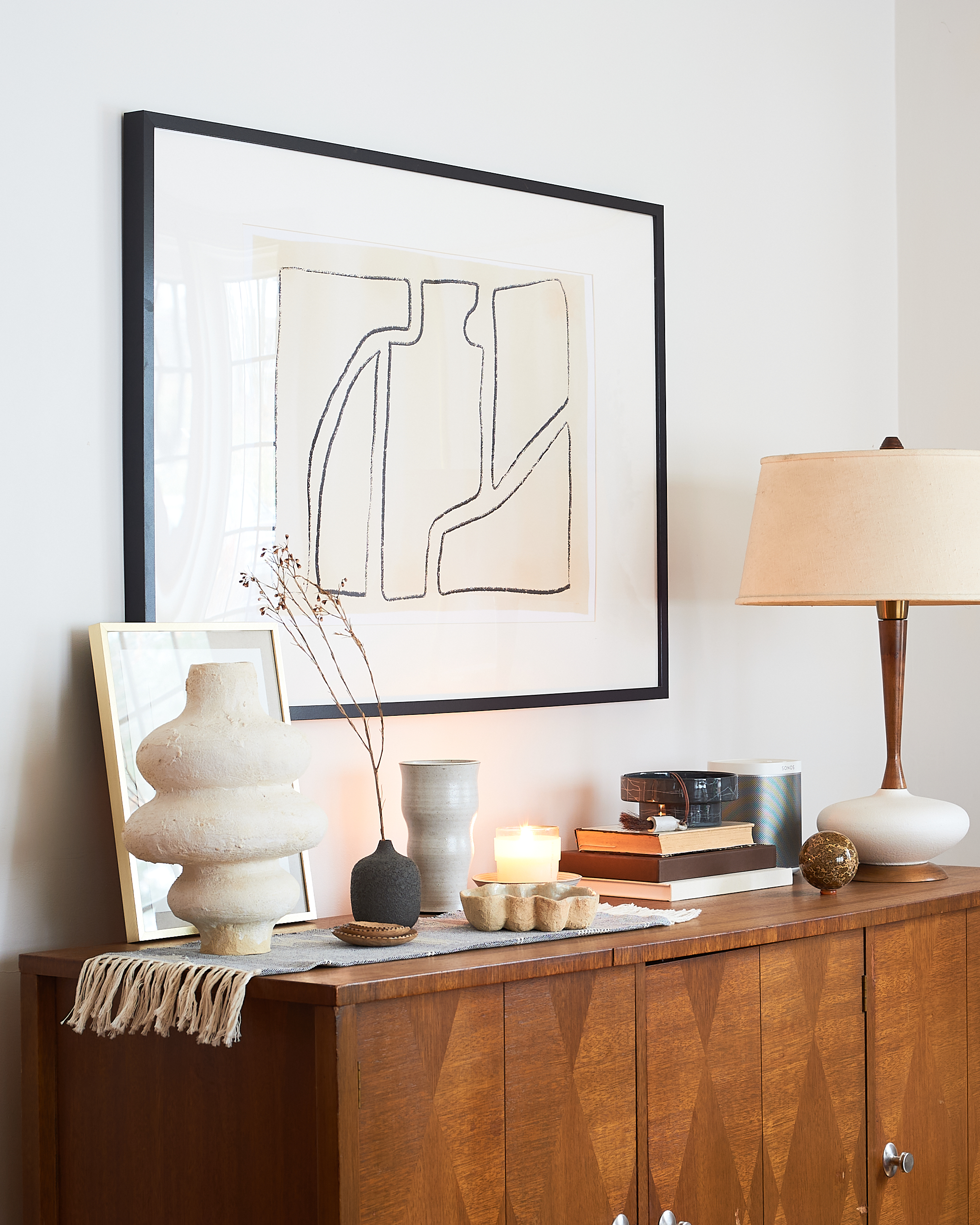 Ceramic vessels styled on a credenza