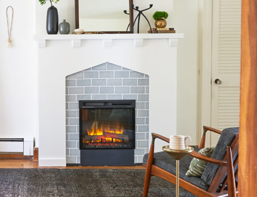 Fireplace with chair in front with drink table