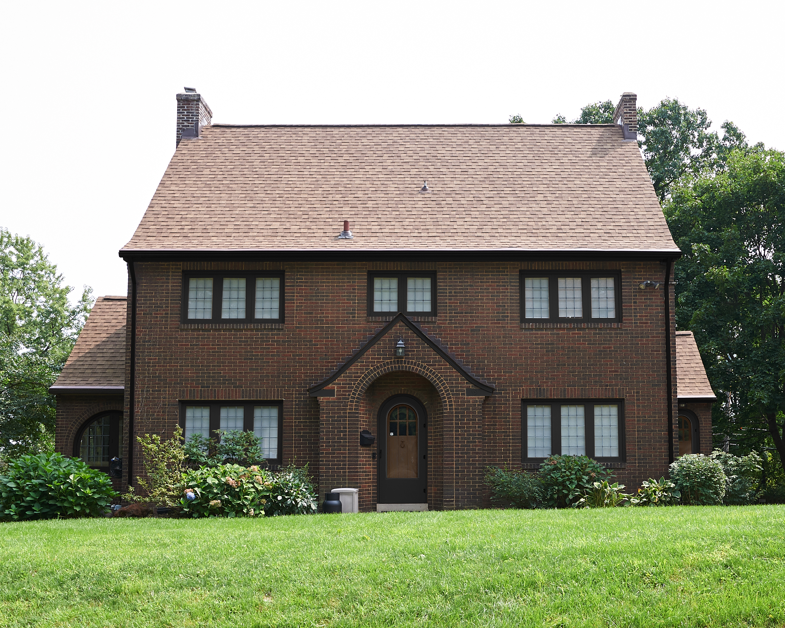 Brick house exterior with SW Black Magic trim.