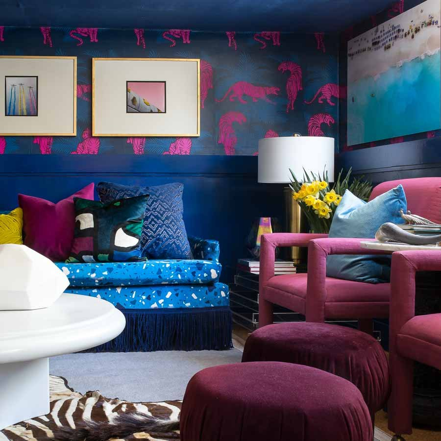 Colorful living room with 80s modern accents and tiger wallpaper.