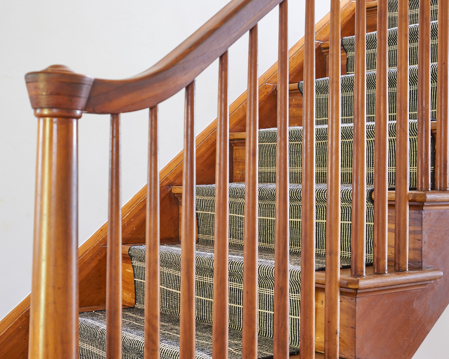 Detail of stair runner through spindles