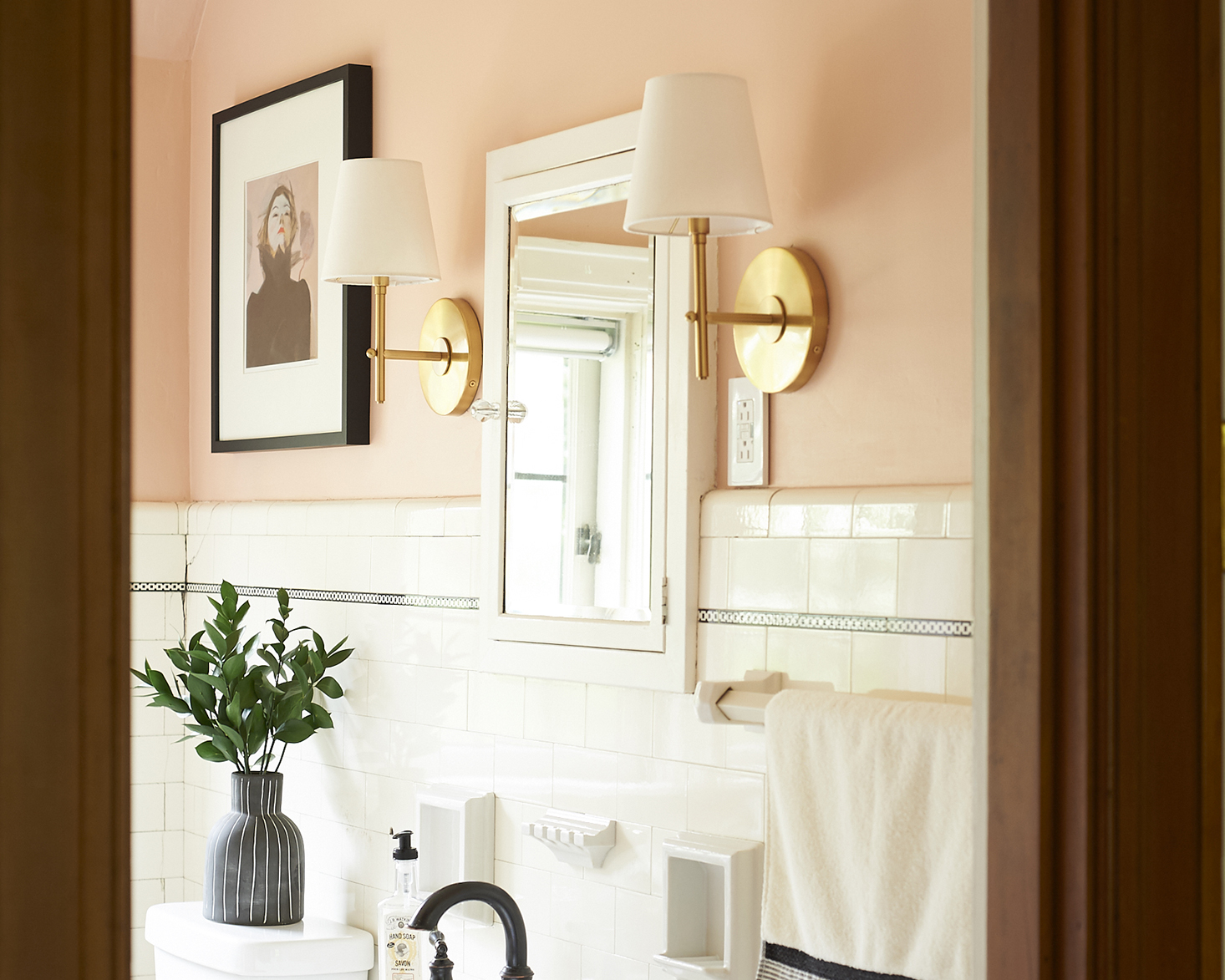 Blush bathroom brass sconces