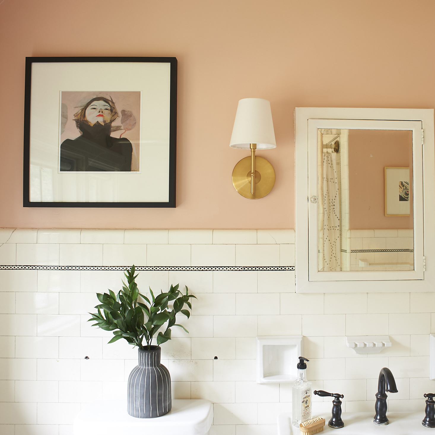 blush bathroom with art